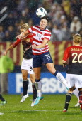 Abby Wambach of the United States goes up for a header against Saskia Burtusiak of Germany during the game on October 23 2012 at Rentschler Field in...