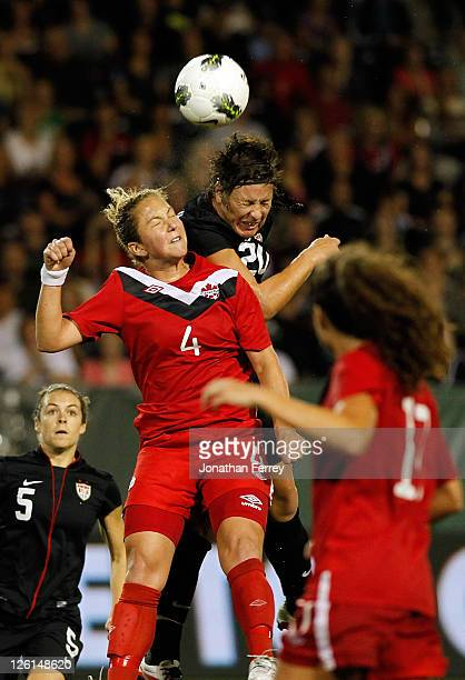 Abby Wambach of the United States heads the ball against Carmelina Moscato of Canada on September 22 2011 at JeldWen Field in Portland Oregon
