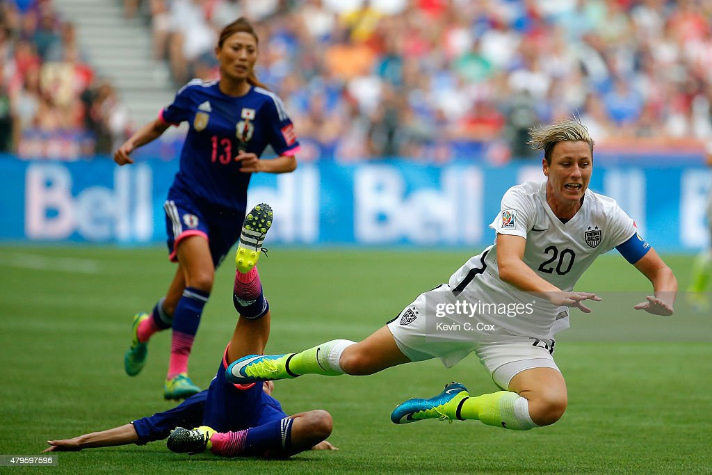 <a gi-track='captionPersonalityLinkClicked' href=/galleries/search?phrase=Abby+Wambach&family=editorial&specificpeople=162757 ng-click='$event.stopPropagation()'>Abby Wambach</a> #20 of the United States is fouled from behind by <a gi-track='captionPersonalityLinkClicked' href=/galleries/search?phrase=Homare+Sawa&family=editorial&specificpeople=744563 ng-click='$event.stopPropagation()'>Homare Sawa</a> #10 of Japan in the second half in the FIFA Women's World Cup Canada 2015 Final at BC Place Stadium on July 5, 2015 in Vancouver, Canada.