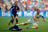 Abby Wambach of the United States is fouled from behind by Homare Sawa of Japan in the second half in the FIFA Women's World Cup Canada 2015 Final at...
