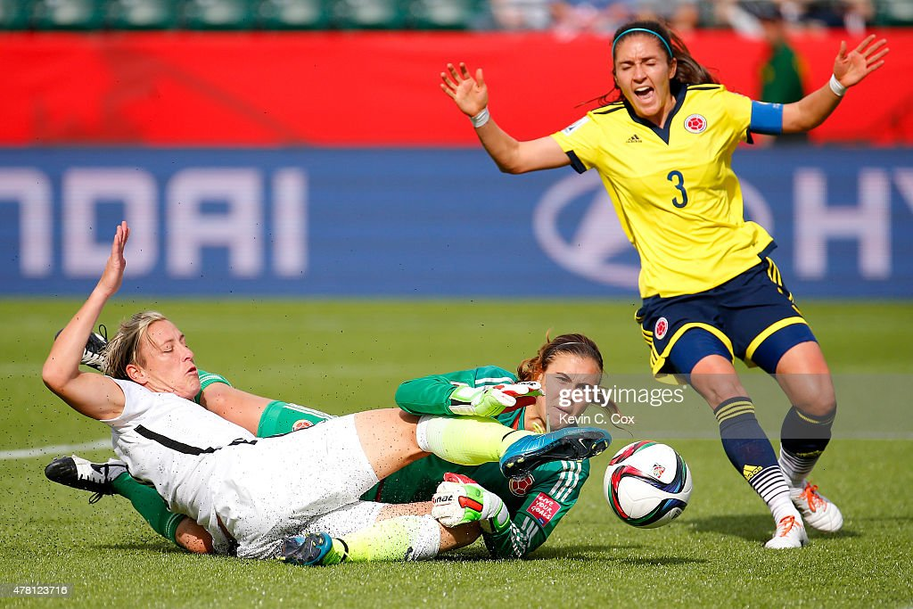 Abby Wambach #20 of the United States kicks the ball away from goalkeeper Catalina Perez #22 of Colombia but Wambach is called for offsides in the first half in the FIFA Women's World Cup 2015 Round of 16 match at Commonwealth Stadium on June 22, 2015 in Edmonton, Canada.