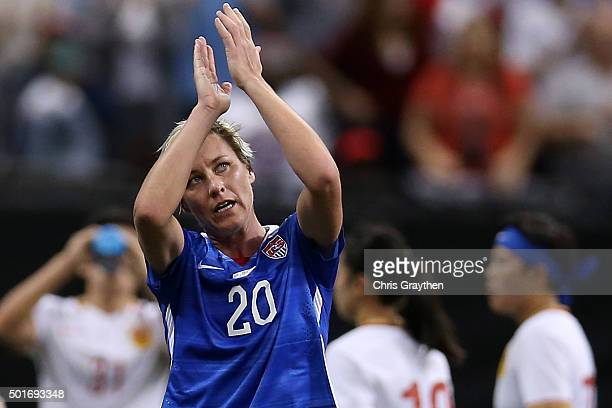 Abby Wambach of the United States reacts after walking off the field for the final time in her career during the women's soccer match against China...