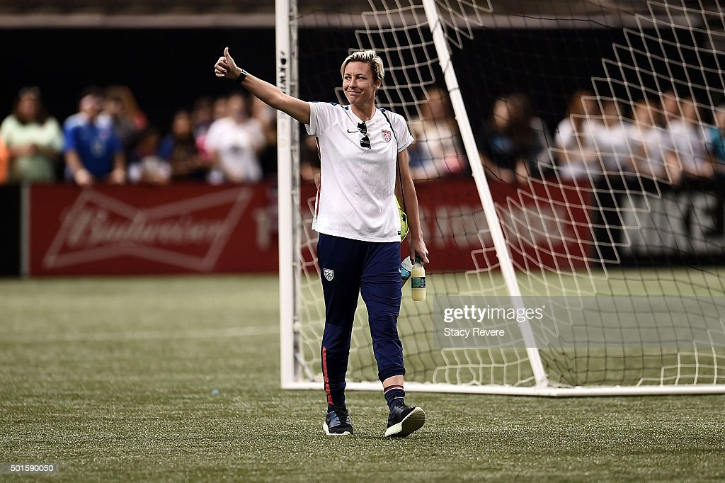Abby Wambach #20 of the United States waves to fans as she leaves the field following a training session held at the Mercedes-Benz Superdome on December 15, 2015 in New Orleans, Louisiana.