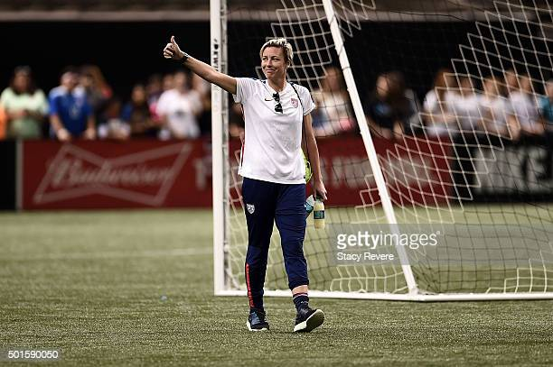 Abby Wambach of the United States waves to fans as she leaves the field following a training session held at the MercedesBenz Superdome on December...