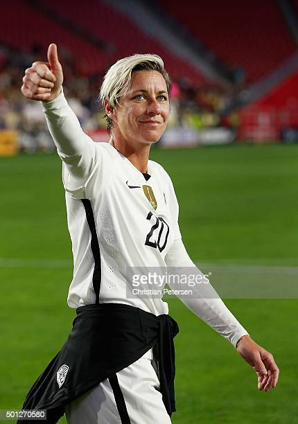 Abby Wambach of the United States waves to fans as she walks off the field following the women's soccer match against China at University of Phoenix...