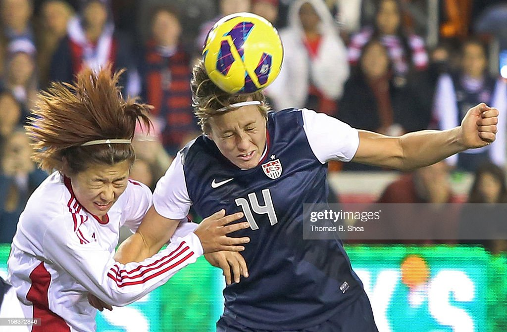 Abby Wambach #14 of the U.S. Women's National Team heads the ball against Li Jiayue defender #4 of the China Women's National Team in an international friendly game at BBVA Compass Stadium on December 12, 2012 in Houston, Texas. USA won 4 to 0.