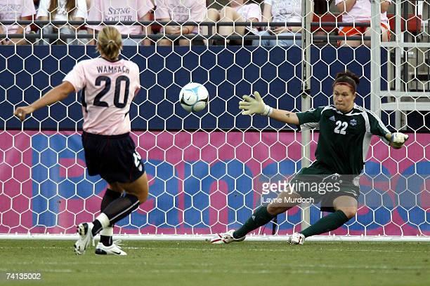 Abby Wambach of the US Women's Soccer Team scores a penalty kick against goalie Erin McLeod of the Canadian Women's Soccer Team at the Pizza Hut Park...