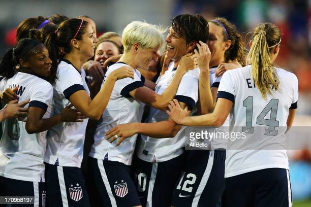 Abby Wambach of the USA celebrates with her teamates after passing Mia Hamm in alltime International total goals scored with her159th International...