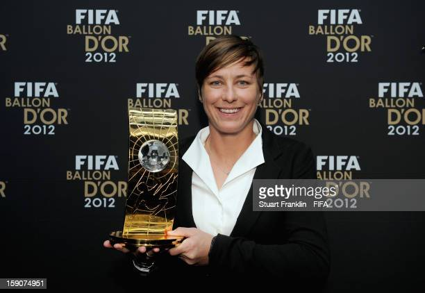 Abby Wambach of the USA holds her trophy after winning the FIFA Women's World Player of the Year award during the FIFA Ballon d'Or Gala 2012 at the...