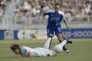 Abby Wambach of the Washington Freedom is knocked to the ground by Staci Burt of the Carolina Courage during the WUSA game on July 31 2002 at SAS...