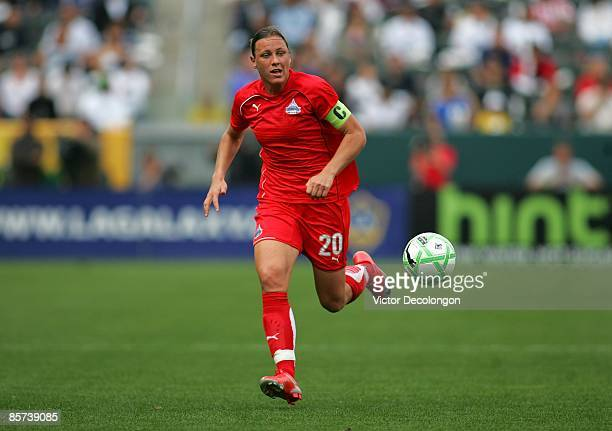 Abby Wambach of the Washington Freedom paces the ball on the right wing during their inaugural WPS match against the Los Angeles Sol at The Home...