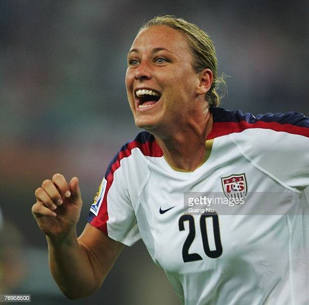 Abby Wambach of USA celebrates after she scored a point during the Womens World Cup 2007 Quarter Final match between the USA and England at Tianjin...