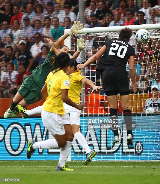 Abby Wambach of USA scores a goal against goalkeeper Andreia of Brazil during the FIFA Women's World Cup quarter final match between Brazil and USA...