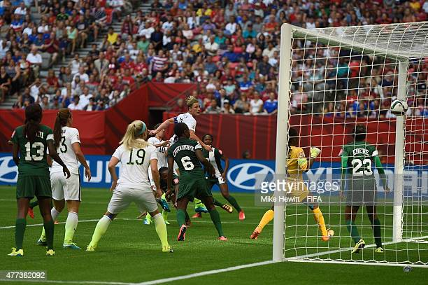Abby Wambach of USA scores her team's first goal during the FIFA Women's World Cup 2015 Group D match between Nigeria and USA at BC Place Stadium on...