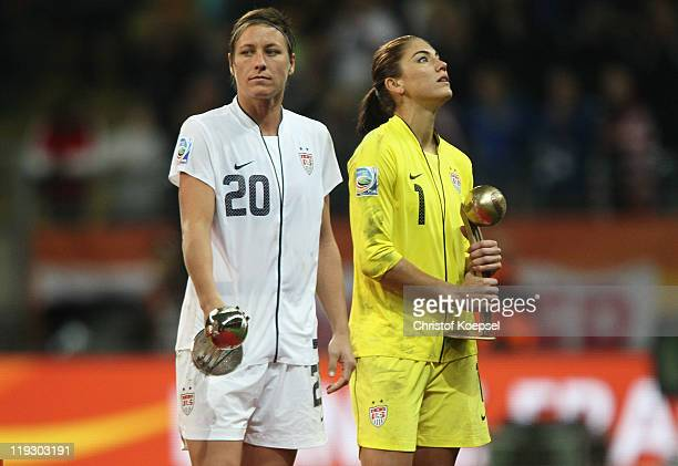Abby Wambach of USA won the adidas silver ball award and Hope Solo won the golden glove award as the best goalkeeper and look dejected after losing...
