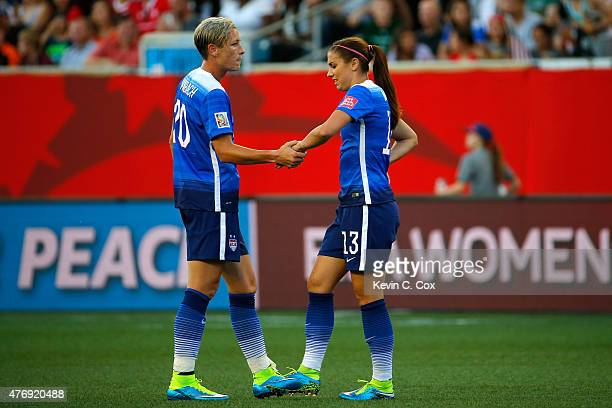 Abby Wambach shakes hands with Alex Morgan of the United States in the second half against Sweden in the FIFA Women's World Cup Canada 2015 match at...