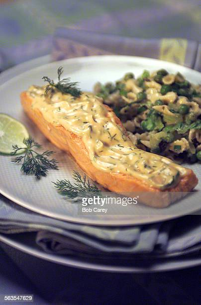 AbbySalmon –– Poached salmon filets in mustard seed broth pasta salad with peas cucumbers romaigne lettuce and fresh mint Plate and napkins from...