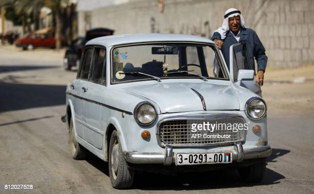 Abd alKarim alAjrami an 83yearold Palestinian elder poses by his vintage 1961model Fiat 1100 car in Gaza City on July 10 2017 / AFP PHOTO / MOHAMMED...