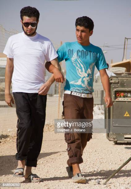 Abdel Ghafour Homsy a former Free Syrian Army fighter from Homs is helped around by a friend in the Moroccan Medical and Surgical Field Hospital at...