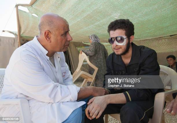 Abdel Ghafour Homsy a former Free Syrian Army fighter from Homs Syria speaks with Dr Gartoum Mohamed a Moroccan Psychiatrist in the Moroccan Medical...