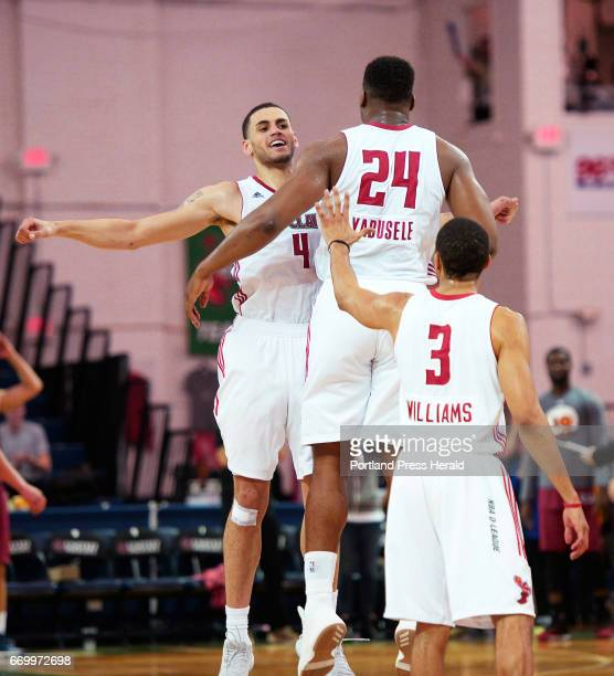 Abdel Nader is swarmed by teammates after scoring a key basket late in the game Wednesday April 12 2017 Guerschon Yabusele and Coron Williams are in...