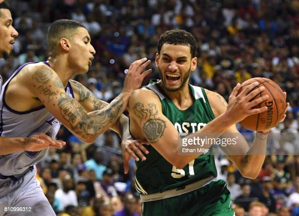 Abdel Nader of the Boston Celtics drives against Kyle Kuzma of the Los Angeles Lakers during the 2017 Summer League at the Thomas Mack Center on July...