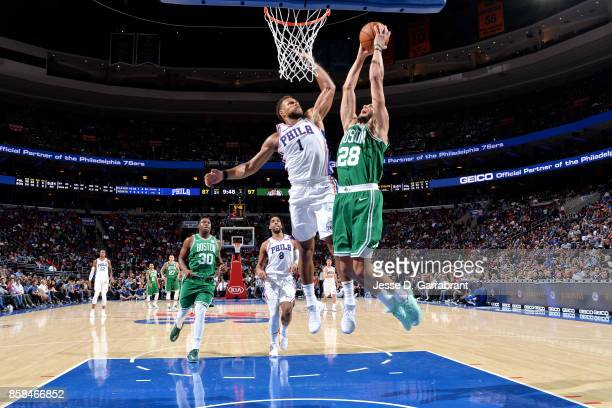Abdel Nader of the Boston Celtics goes for a dunk during the game against Justin Anderson of the Philadelphia 76ers during a preseason on October 6...