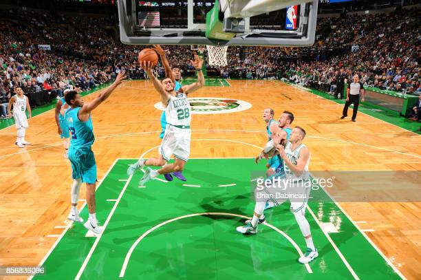 Abdel Nader of the Boston Celtics goes to the basket against the Charlotte Hornets during a preseason game on October 2 2017 at the TD Garden in...
