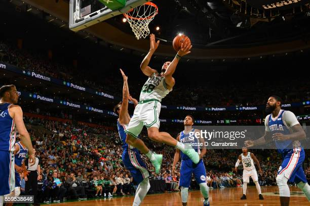 Abdel Nader of the Boston Celtics goes to the basket against the Philadelphia 76ers during a preseason game on October 9 2017 at TD Garden in Boston...