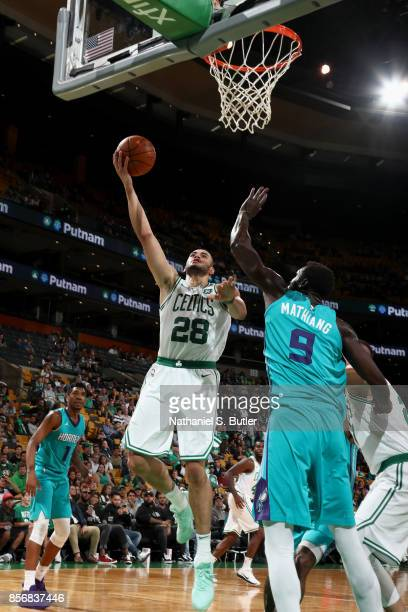 Abdel Nader of the Boston Celtics goes to the basket against the Charlotte Hornets on October 2 2017 at the TD Garden in Boston Massachusetts NOTE TO...