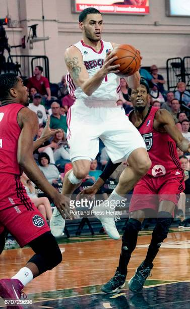 Abdel Nader of the Maine Red Claws cuts through 905 Raptor defenders Yanick Moreira and Antwaine Wiggins on his way to the basket in the first half...