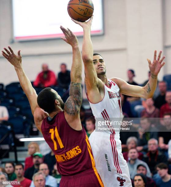 Abdel Nader of the Maine Red Claws drives to the basket on Trey McKinneyJones of the Fort Wayne Mad Ants Wednesday April 12 2017