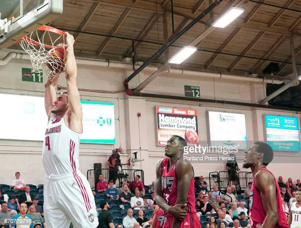 Abdel Nader of the Maine Red Claws dunks on a fast break in front of Pascal Siakam and Antwaine Wiggins of the 905 Raptors in a NBA DLeague playoff...