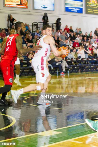 Abdel Nader of the Maine Red Claws tries to spin to the hoop against C J Leslie of the Raptors 905 in Game 1 of the NBADL Eastern Conference Finals...