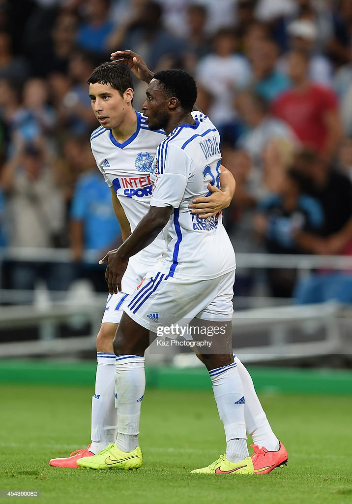Abdelaziz Barrada (L) of Marseille celebrates scoring his team's fourth goal with his teammate Brice Dja Djedje during the French Ligue 1 match between Olympique de Marseille and OGC Nice at Stade Velodrome on August 29, 2014 in Marseille, France.