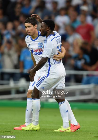 Abdelaziz Barrada of Marseille celebrates scoring his team's fourth goal with his teammate Brice Dja Djedje during the French Ligue 1 match between...