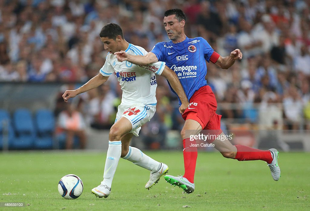 Abdelaziz Barrada of OM and Julien Feret of SM Caen in action during the French Ligue 1 match between Olympique de Marseille and SM Caen at Stade...