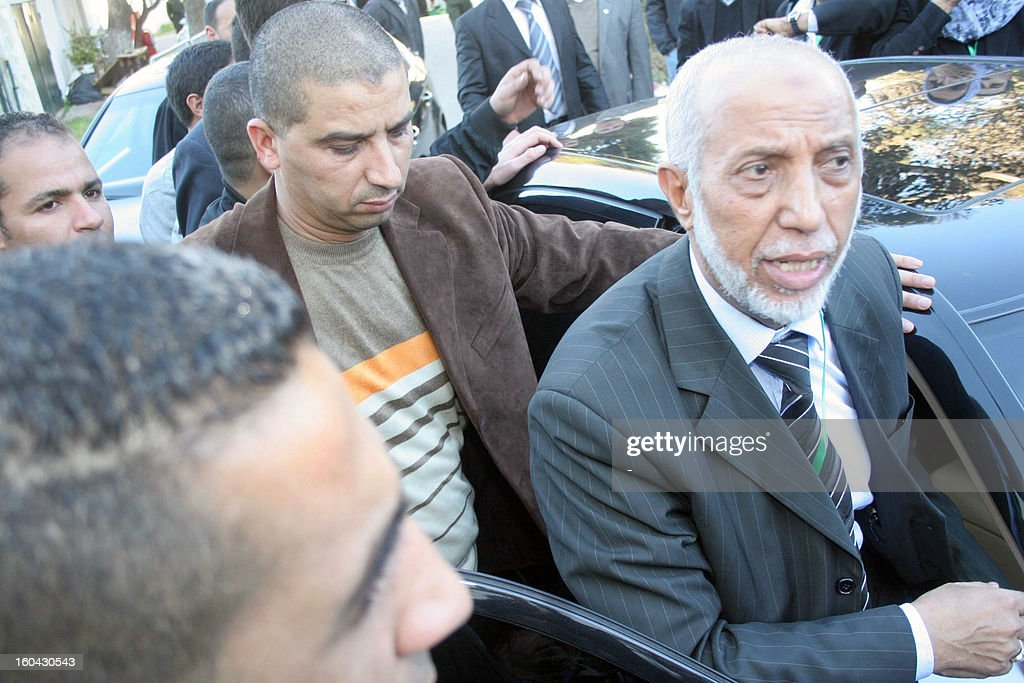Abdelaziz Belkhadem (R), leaves following a meeting of the National Liberation Front which included a vote of confidence over Belkhadem's position, in Algiers on January 31, 2013. The central committee of Algeria's ruling party relieved its chief Belkhadem of his duties, an AFP journalist reported. AFP PHOTO/STR