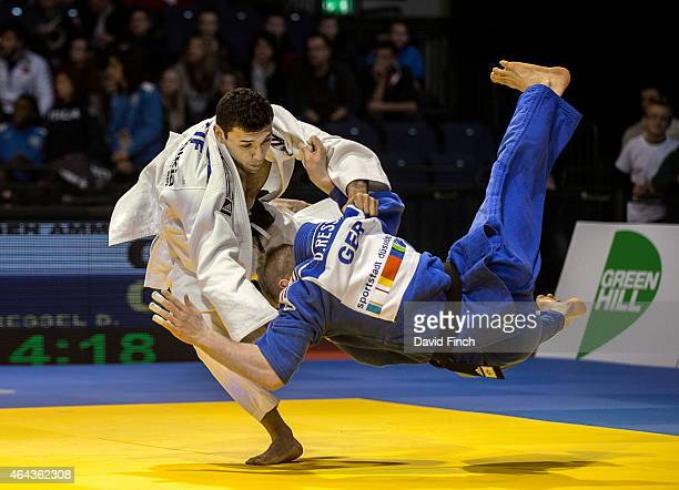 Abdelaziz Ben Ammar of Tunisia sweeps the legs from under Dominic Ressel of Germany eventually winning the u81kg contest by an ippon from a hold...
