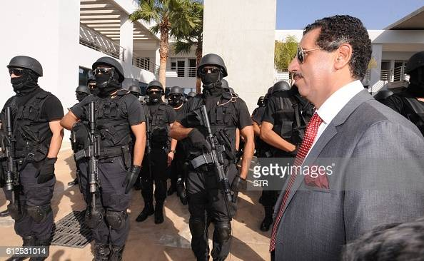 Abdelhak Khiam the Moroccan governor of the Central Office of Criminal Investigation stands before members of the Moroccan special forces following a...