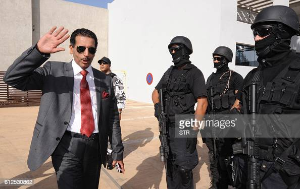 Abdelhak Khiame the Moroccan governor of the Central Office of Criminal Investigation gestures in before members of the Moroccan special forces...