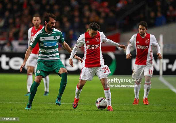 Abdelhak Nouri of Ajax evades Giorgios Koutroubis of Panathinaikos during the UEFA Europa League Group G match between AFC Ajax and Panathinaikos FC...
