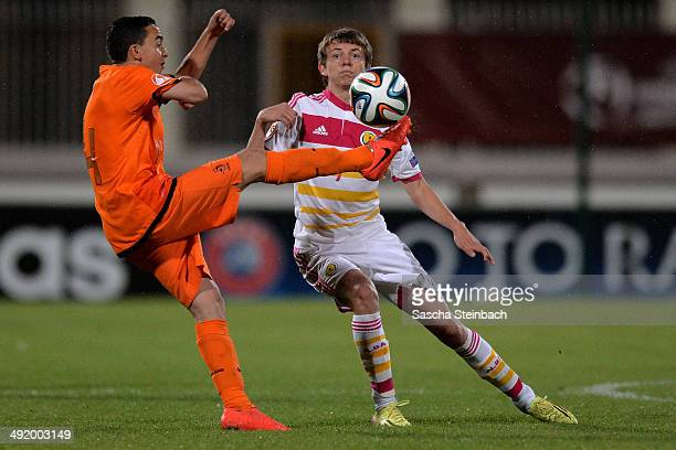 Abdelhak Nouri of Netherlands battles for the ball with Aidan Nesbitt of Scotland during the UEFA Under17 European Championship 2014 semi final match...