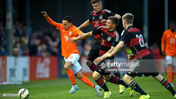 Abdelhak Nouri of Netherlands is challenged by Erik Wekesser Enis Bunjaki and Joshua Endres of Germany during the U19 international friendly match...