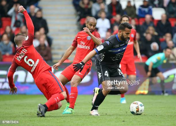 Abdelhamid El Kaoutari of Bastia Marco Verratti and Lucas Moura of PSG during the French Ligue 1 match between Paris SaintGermain and SC Bastia at...