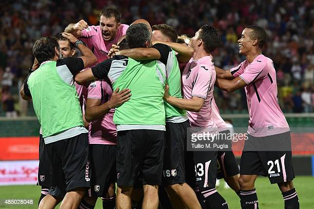 Abdelhamid El Kaoutari of Palermo celebrates with team mates after scores the opening goal during the Serie A match between US Citta di Palermo and...