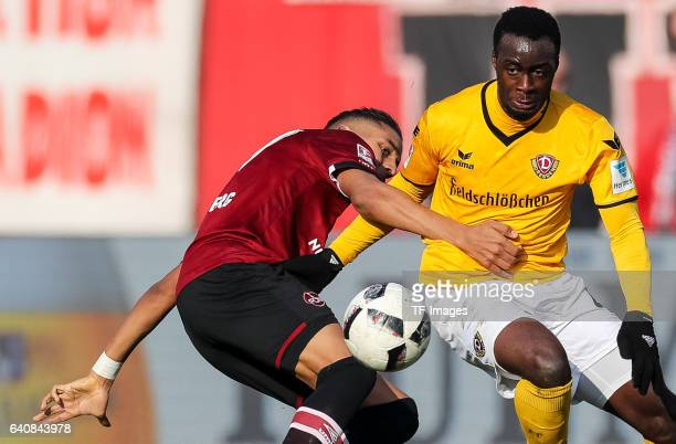 Abdelhamid Sabiri of FC Nuernberg and Erich Berko of Dynamo Dresden battle for the ball during the Second Bundesliga match between 1 FC Nuernberg and...