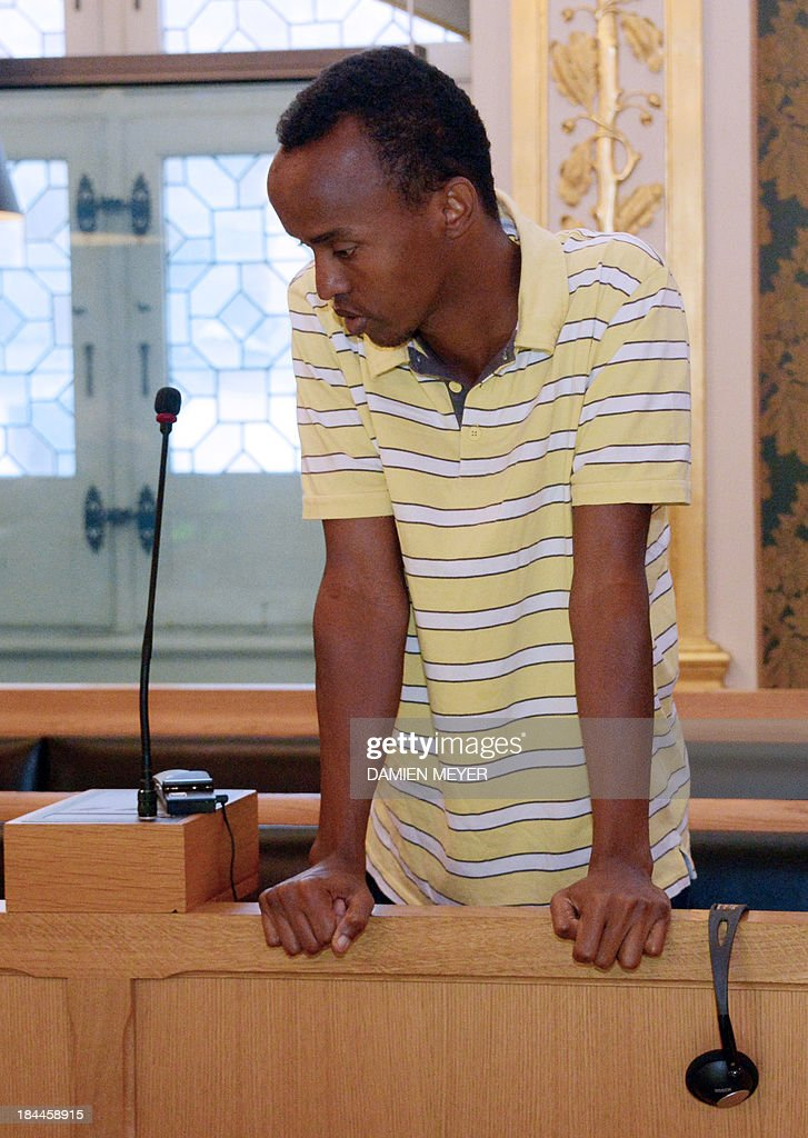 Abdelkader Osmane Ali , one of the three Somali pirates arrested by French soldiers in 2009 Mahmoud Abdi Mohammed waits in the accused box, on October 14, 2013 at Rennes' courthouse, prior to the opening hearing of their trial for hijacking a yacht in 2009. French troops stormed the Tanit sailboat on April 10, 2009 and captured the trio in a bid to free Florent Lemacon, his wife, their three-year-old son and two others.