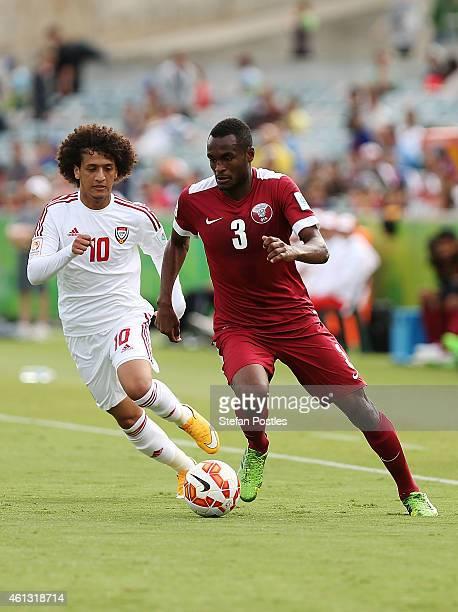 Abdelkarim Hassan of Qatar beats Omar Abdulrahman of the United Arab Emirates during the 2015 Asian Cup match between the United Arab Emirates and...