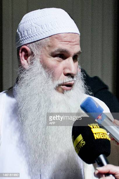Abdelkrim Azagnui talks to the press outside the Court of Assizes in Brussels on June 11 after the announcement of the verdict of the trial of Mourad...